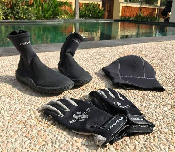 A neoprene hood, a pair of diving gloves and boots can make a big difference to keep you warm underwater.